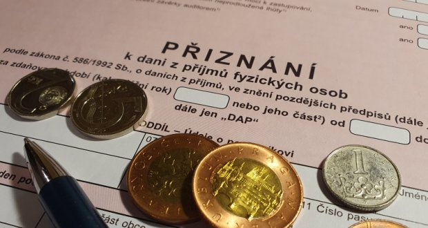 The picture shows Czech koruna and PIT form